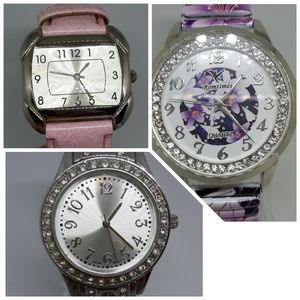 3 watches pink, purple floral, and crystal.